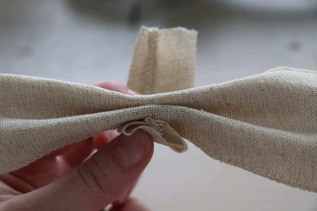 Glue the loop to the bow by starting at the bottom-loop from the back around to the front.