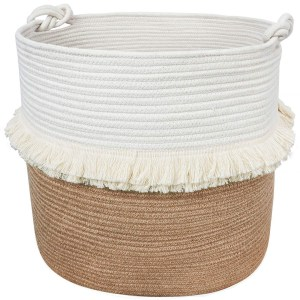 A large white and woven jute basket with fringe around the middle.