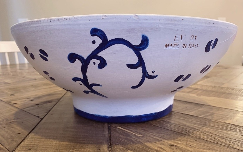 A clay planter bowl, hand painted in a white and blue motif.