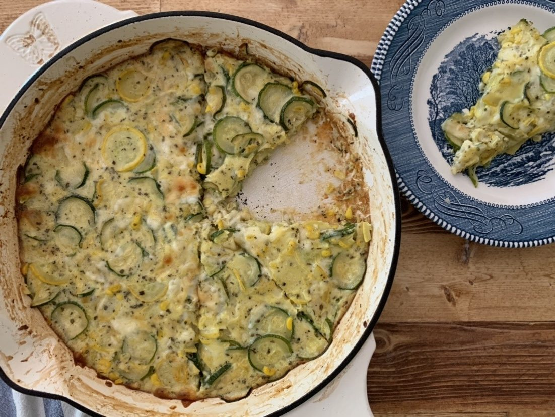 A skillet of fresh zucchini and corn pie.