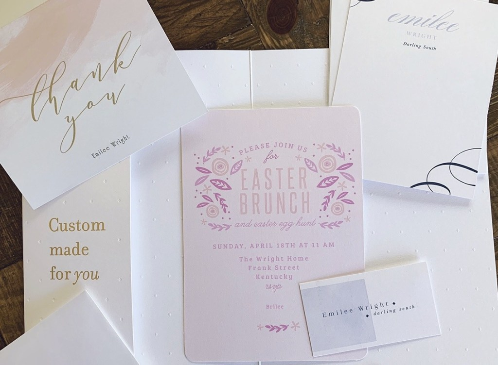 An assortment of custom stationery including an invitation, thank you card, and business card.