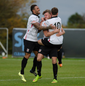 Leon Scott and Nathan Cartman congratulate Lee Gaskell on his first goal