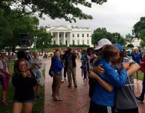 Three-way hug of Darren, Sandy and Lauren.