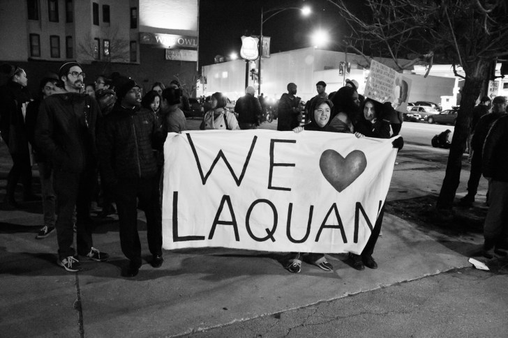 """Protester's sign reads """"We (Heart) Laquan"""". #LaQuanMcDonald was killed by Chicago Police at it appears that his killing was covered up by the city."""