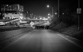 A group of protesters makes their way down the Racine onramp to attempt to block traffic on the west-bound I-290 Expressway.