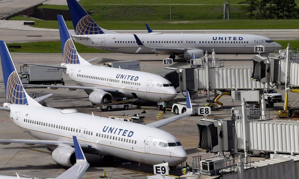 A United passenger's laptop battery caught fire mid-flight, forcing the pilot to make an emergency landing in Florida (UAL)