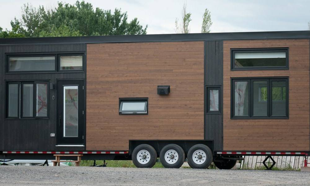 This $115,949 loft-style tiny home on wheels has a living room that doubles as an office — see inside
