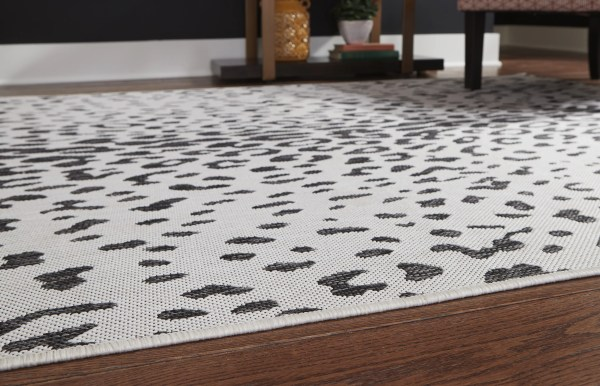 Corner of R405021 Samya Rug Go wild with this indoor/outdoor animal print rug, thanks to its black, white and gray color palette.