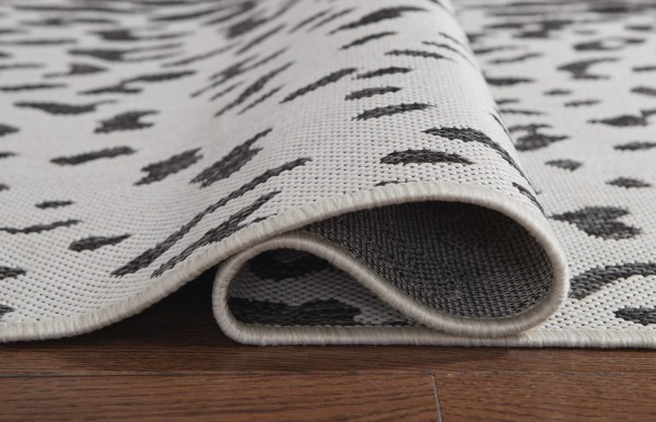 Rug Backing for R405021 Samya Rug Go wild with this indoor/outdoor animal print rug, thanks to its black, white and gray color palette.