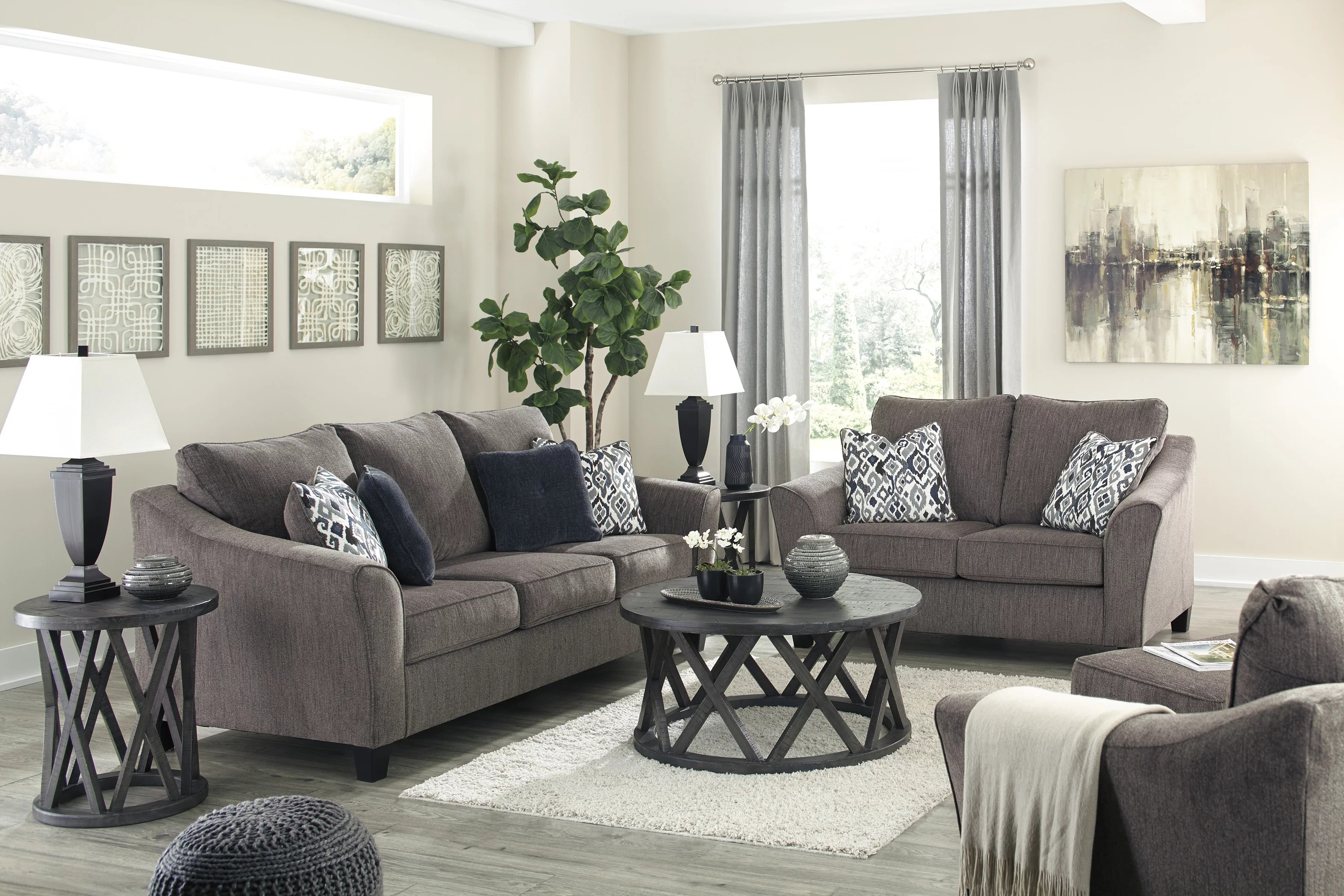Room picture of the Nemoli Sofa and Loveseat sets the scene for a modern space full of casual flair with its flared arms. Its textured chenille with solid microfiber upholstery provides a luxuriously soft feel that's inviting.