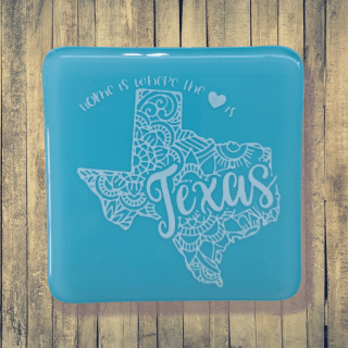 Teal state of Texas fused glass coaster. Handcrafted by DarteGlass, a woman owned business.