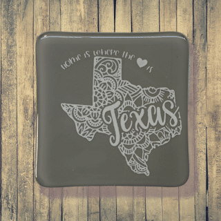 Gray state of Texas fused glass coaster. Handcrafted by DarteGlass, a woman owned business.