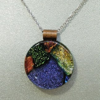 Large round multicolored fused glass pendant, handcrafted by DarteGlass, a woman owned company.