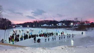 the opening ceremony of the ice rink on a lake in front of our halls of residence