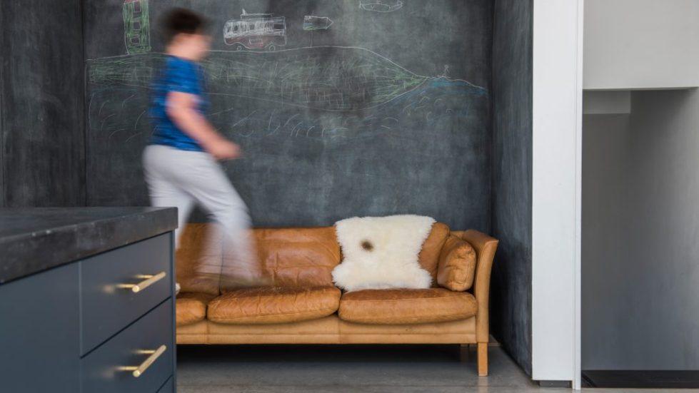 kid jumps across sofa