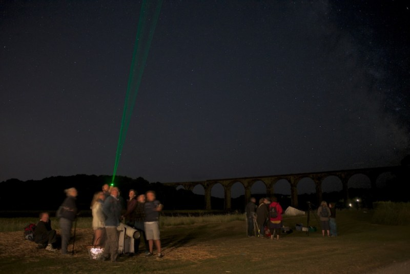 Group of people being shown constellations on the Port Eliot estate