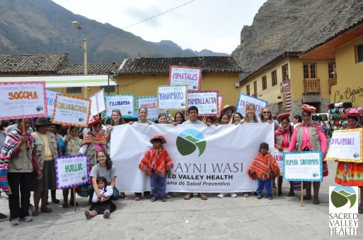 Promotoras and Ayni Wasi staff gather to march in parade for the anniversary of Ollantaytambo