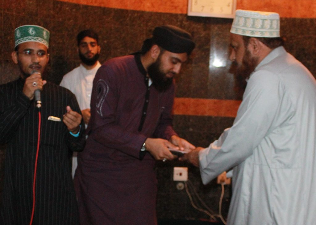 Hafiz Furqan Raza is presented with the albums produced by the Darul Uloom Pretoria. Presented by his Ustadh Qari Noor Alam.