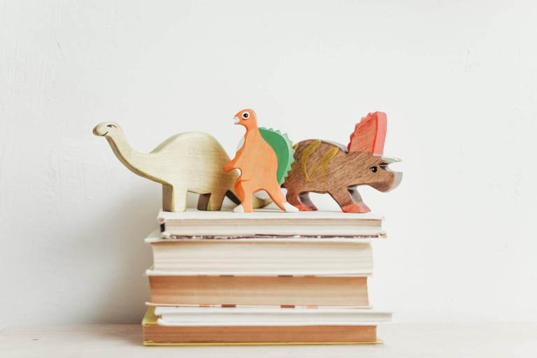 three wooden dinosaur