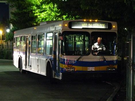 """A transit bus waits during a """"layover"""" at Surrey Central SkyTrain Station. Photo credit: CC-BY-NC-SA Flickr: Dennis Tsang"""