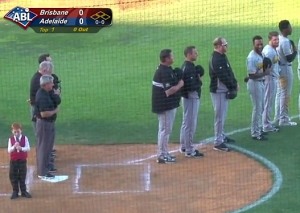 Players, coaches and the crowd start to giggle as they hear 7-year-old Ethan Hall sing the Australian national anthem with a bad case of hiccups.