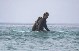 The sea lion pup thought it would be fun to hold on like he and new friend, surfer Dan Murphy, were riding a motorcycle.