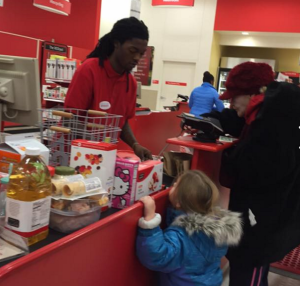 A little girl named, Eloise, gets a real-life lesson in kindness and patience as a Target cashier works with an older woman who is paying for her order using coins.