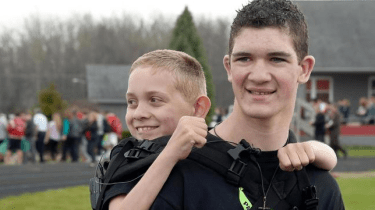 Hunter Grandee walks over 100 miles as he carries his brother on his back. They are raising awareness about cerebral palsy.