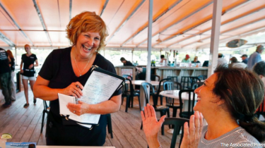 Maine governor's wife, Ann LePage, is spending her summer waiting tables in a seaside town to earn extra money for a new car.