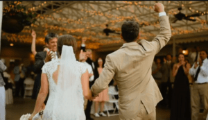 Together, these newlyweds overcame their first married obstacle-the groom getting bitten by a rattlesnake. The party goes on!