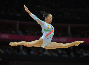 Tiny, but mighty and strong--Chinese gymnast, Deng LinLin was the shortest female Olympian at the London Games in 2012.