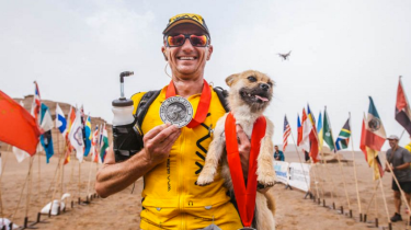 Runner Dion Leonard is adopting a mutt dog who followed him for days through an ultra-marathon race in China's Gobi Desert.