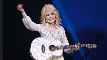 "Dolly Parton starts her ""My People Fund,"" offering $1000 per month for each family who has lost their home during the Tennessee fires until they get back on their feet."
