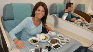 MilesHusband and I enjoying one course in a 7-course dinner aboard Korean Air First Class. Seoul-Atlanta. We had the entire 12-seat First Class cabin to ourselves. The one way tickets would've cost $10,400. MilesHusband paid $200 per person & 80,000 miles.