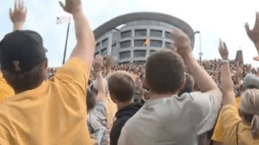 Hawkeye football fans at the University of Iowa start a new tradition standing up to wave at the Iowa Stead Family Children's Hospital that sits across from the Hawkeye's stadium.