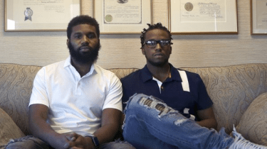 Rashon Nelson and Donte Robinson being led away in handcuffs April 12, and charged with trespassing in a Philadelphia Starbucks, causing national outrage.