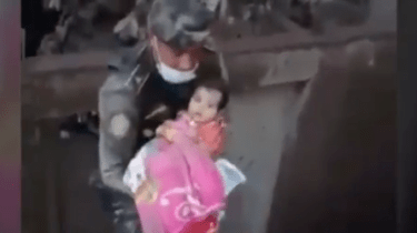 Miracle volcano baby is rescued from ash covered building in Guatemala.