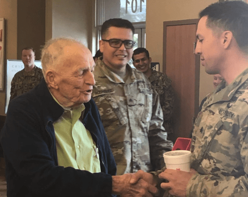 WWII veteran Ed Rusinek spends $1500 treating military members to a free lunch in honor of his 92nd birthday at Chick fil-A.