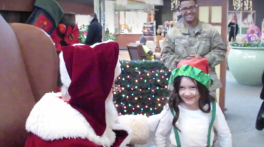 Ella doesn't realize that Santa is about to reunite her with her soldier dad.