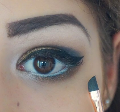create the cat eye, apply mascara, falsies and one coat of mascara, don't forget to use concealer under your eyes
