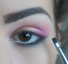 apply matte black eyeshadow in the outer corner of your lower lash line; Brush- Sigma E17, Shade- KIKO Milano Infinity 295