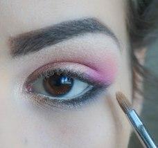 highlight the inner corner or your eye with glittery eyeshadow; Brush- Sigma E46