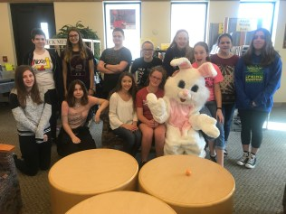 Group of students posting with Easter bunny