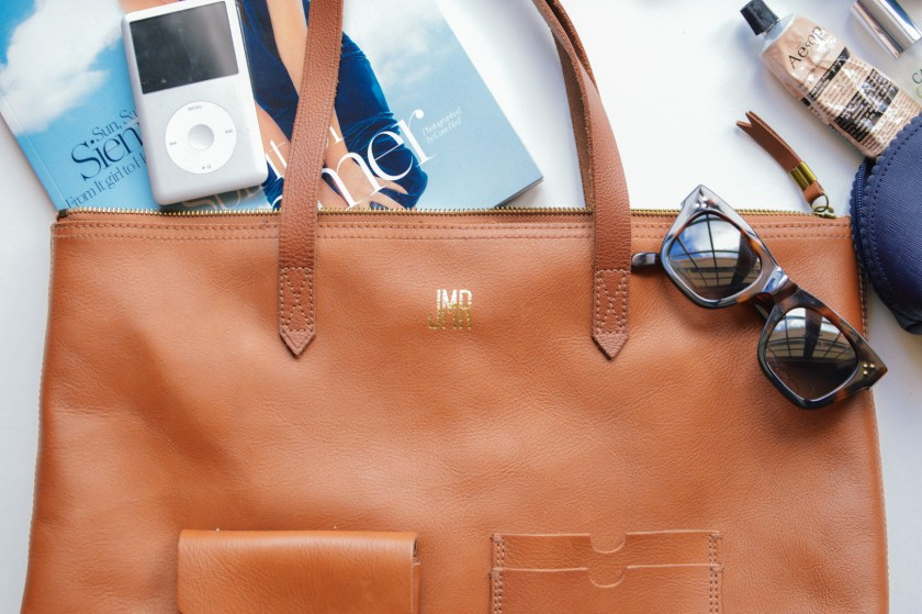 Travel essentials in a Madewell Leather Tote