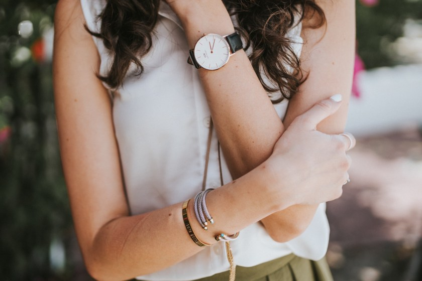 Jackie wearing a Daniel Wellington watch and her jewelry details