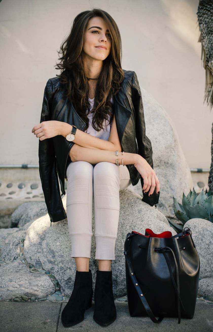 Jackie Roque styling Sincerely Jules Joggers, Mansur Gavriel Bucket Bag and a leather jacket