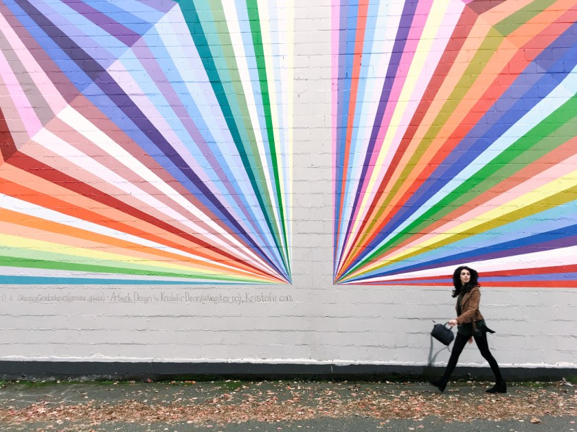 Jackie Roque in the rainbow wall Vancouver