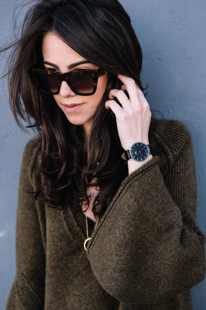 Jackie Roque styling a free people bell sleeve sweater, celine sunglasses, daniel wellington and a gorjana necklace.