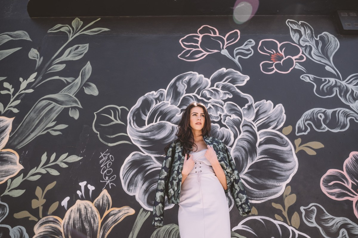 Jackie Roque styling a Toyshop dress and Banana Republic jacket in Wynwood Miami.