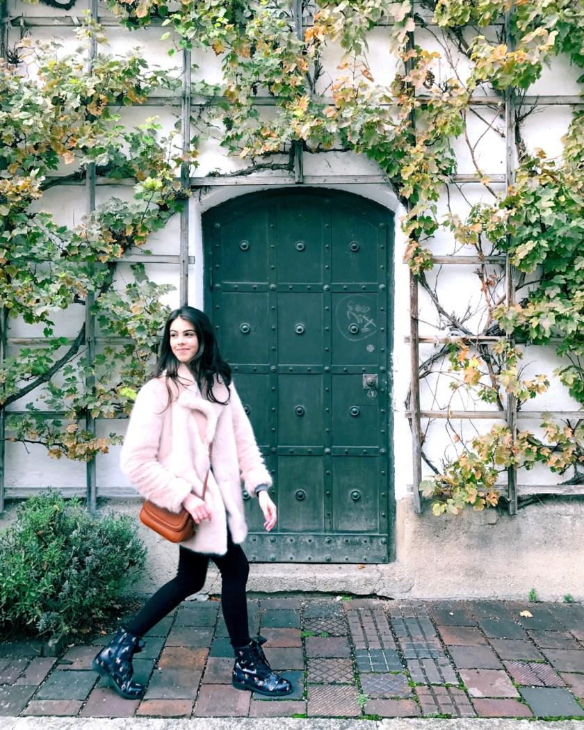 Jackie Roque styling a Zara pink faux fur coat in Munich Germany.